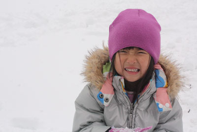 Girl crying in the snow